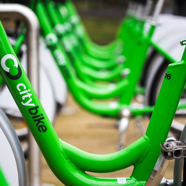 """Green city bikes at Sefton Park"" stock image"