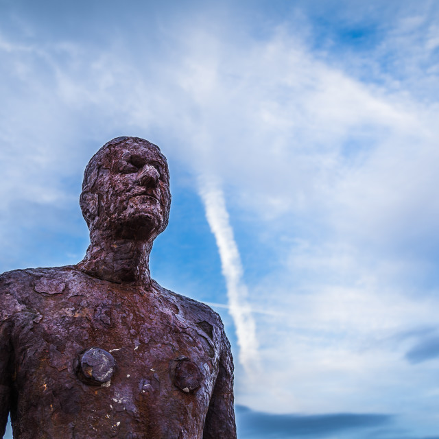 """Looking up at one of the Iron Men"" stock image"