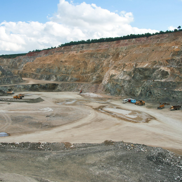 """Bottom of surface mining and machinery in an open pit mine"" stock image"