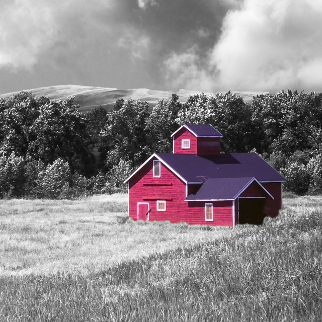 """Red building alone in a field"" stock image"
