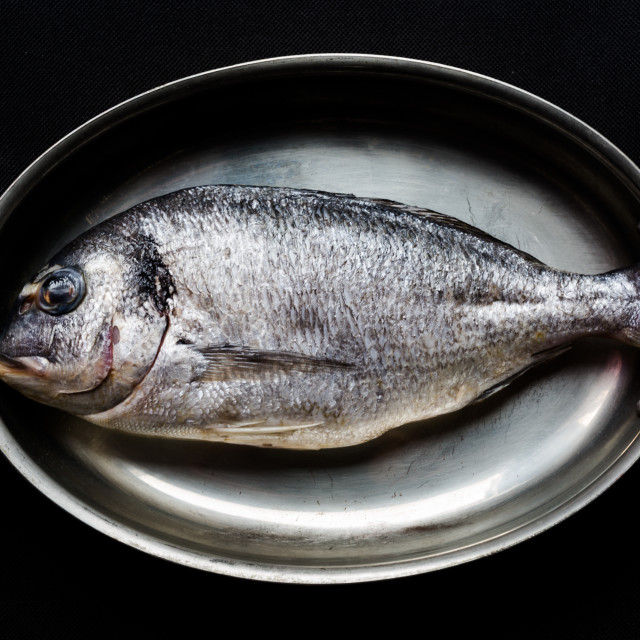 """""""Sea bream on old vintage copper fryer in dull faded light"""" stock image"""