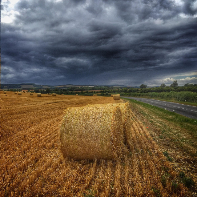 """""""Storm approaching over farmland"""" stock image"""