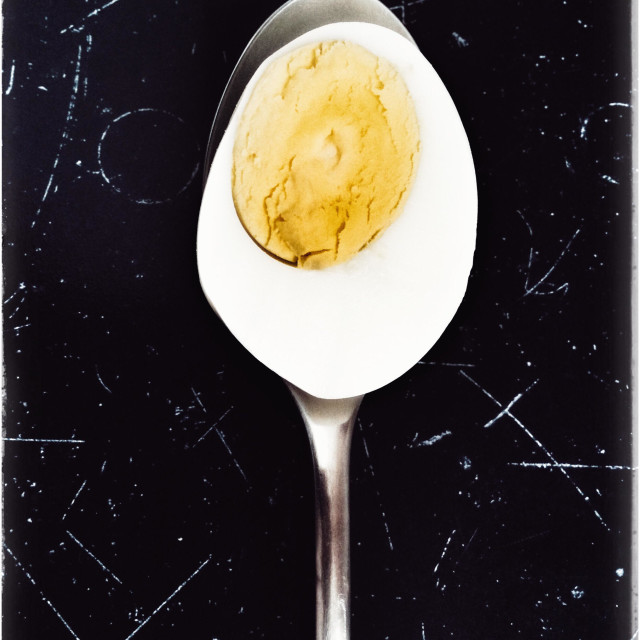 """Hard boiled egg on spoon."" stock image"