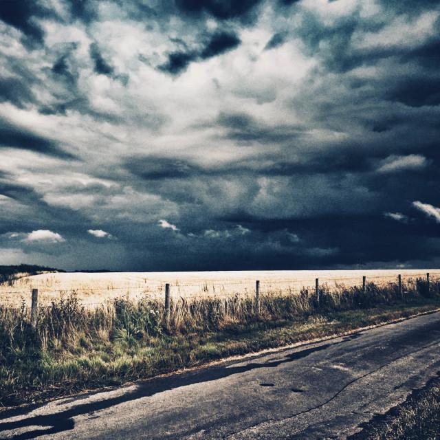 """Storm approaching across farmland"" stock image"