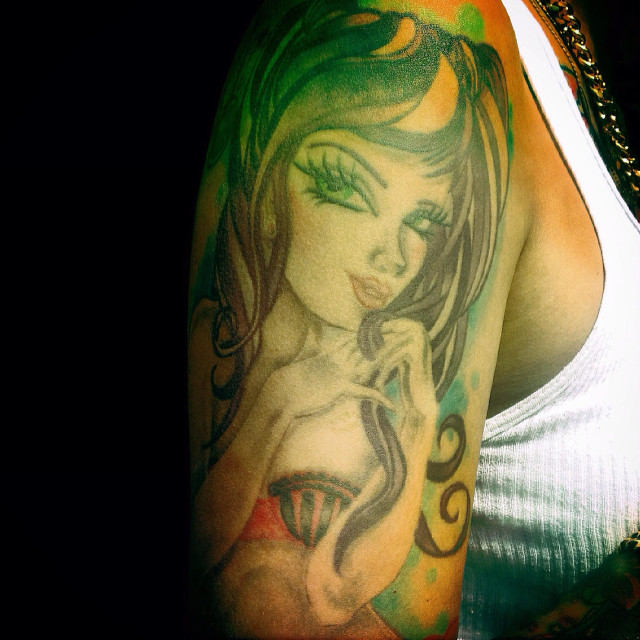 """""""A tattoo of a young woman with blue eyes in Colonia Roma, Mexico City, Mexico"""" stock image"""