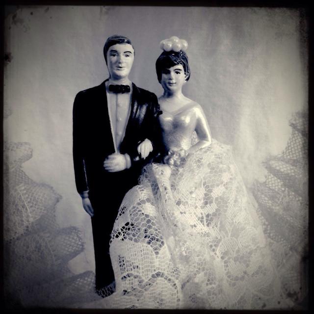 """Vintage bride and groom wedding cake topper"" stock image"