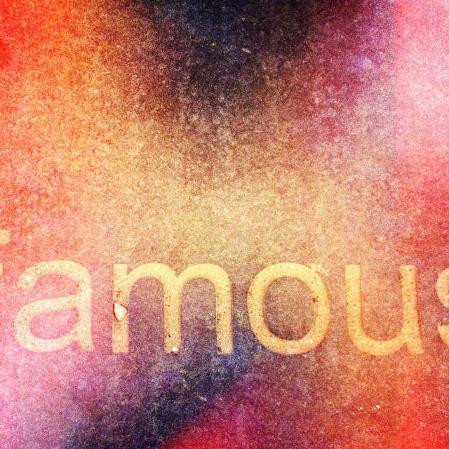 """""""The word famous on a paving stone"""" stock image"""