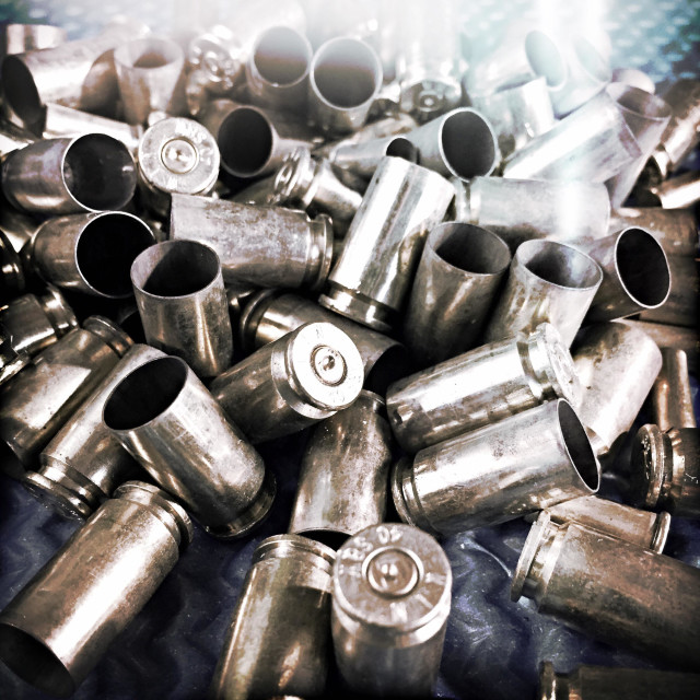 """""""Brass spent cartridges in a stack"""" stock image"""