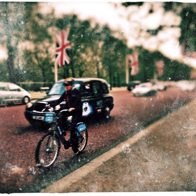 """Cyclist on The Mall, City of Westminster, Central London, England, United Kingdom, Europe"" stock image"
