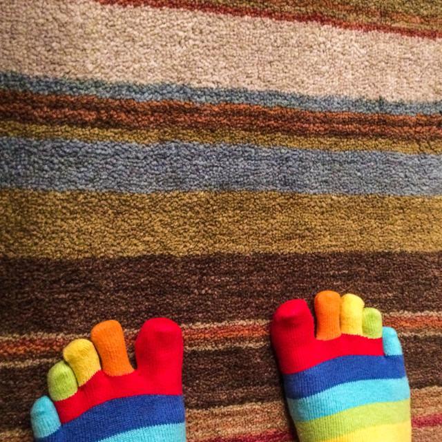 """""""Stripy socks on a stripy carpet"""" stock image"""