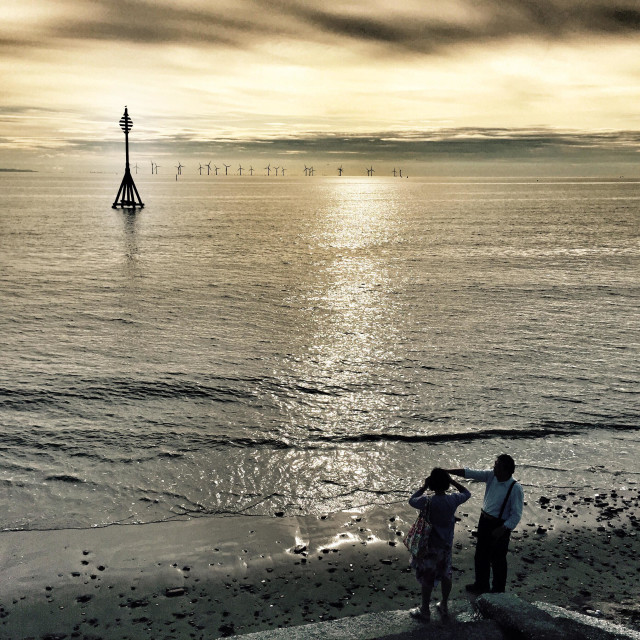 """""""Looking out to sea. Crosby beach sunset."""" stock image"""