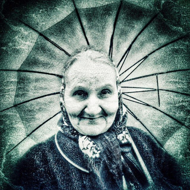 """Woman holding an umbrella"" stock image"