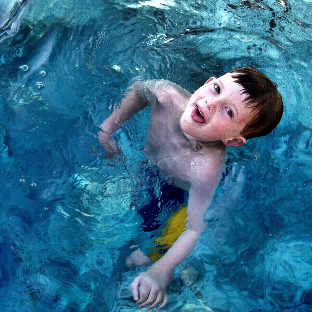 """Silly Boy Swimming"" stock image"