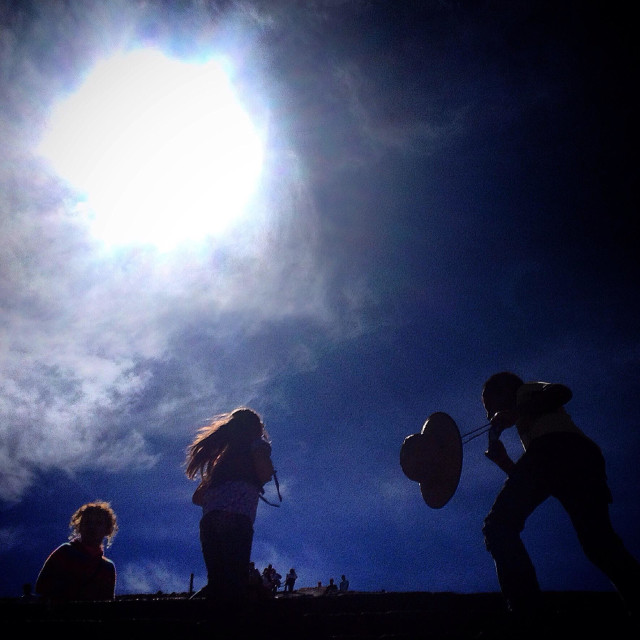 """""""A family walk on top of the Pyramid of the Sun in Teotihuacan, Mexico"""" stock image"""