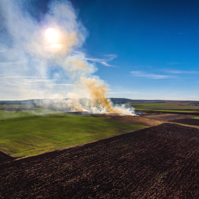 """Aerial view of fire on autumn field"" stock image"