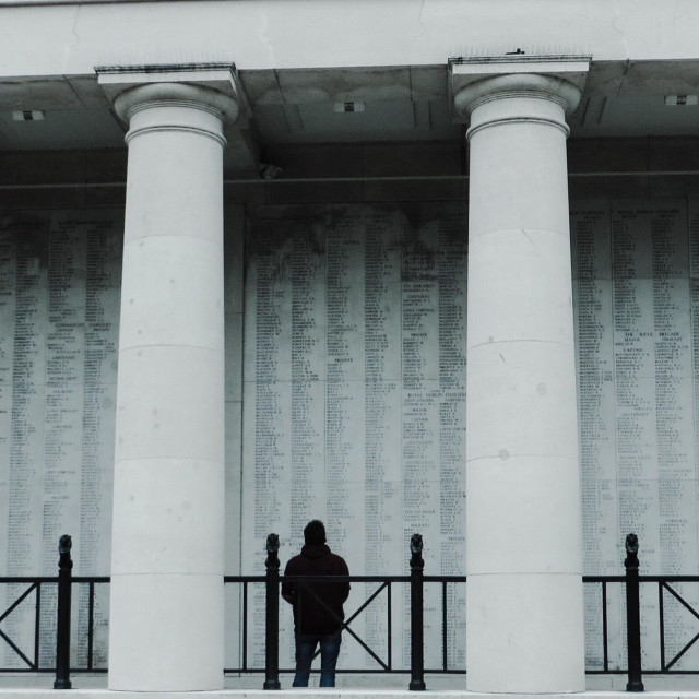 """Man looking at the names on the Menin Gate Ypres Belgium"" stock image"