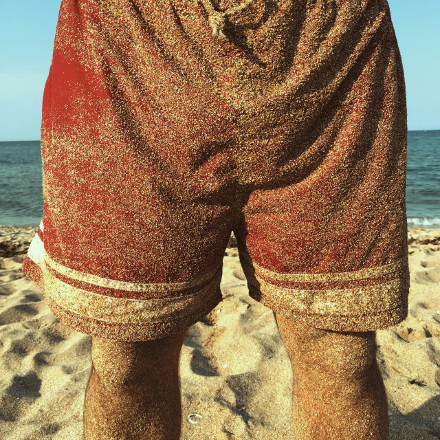 """Man shorts, swimming costume with sand"" stock image"