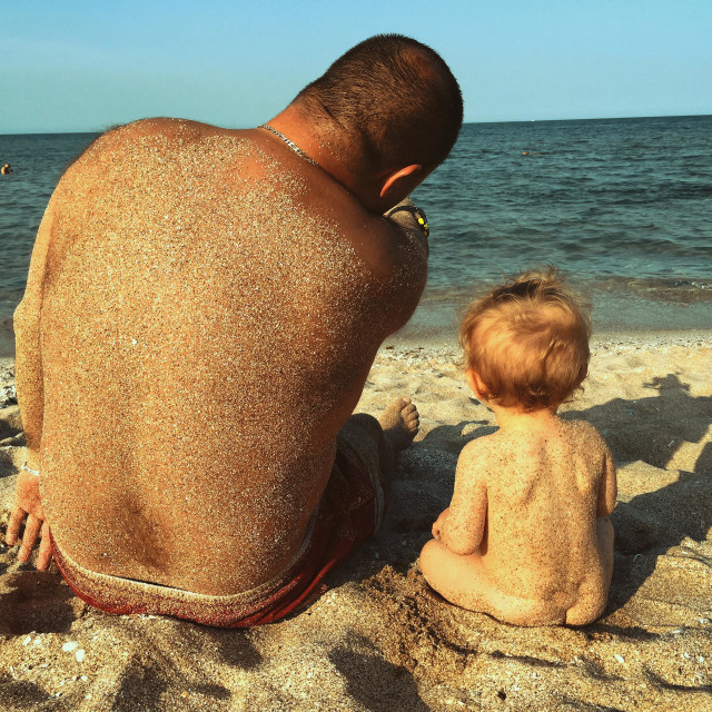 """""""Father and Children on the beach"""" stock image"""