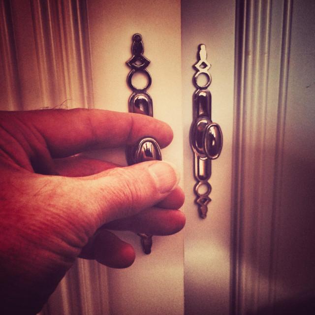 """""""Opening a cupboard door"""" stock image"""