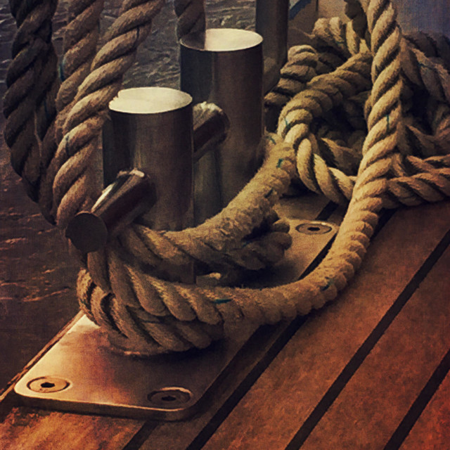 """""""Cleats and rope on the wooden deck"""" stock image"""