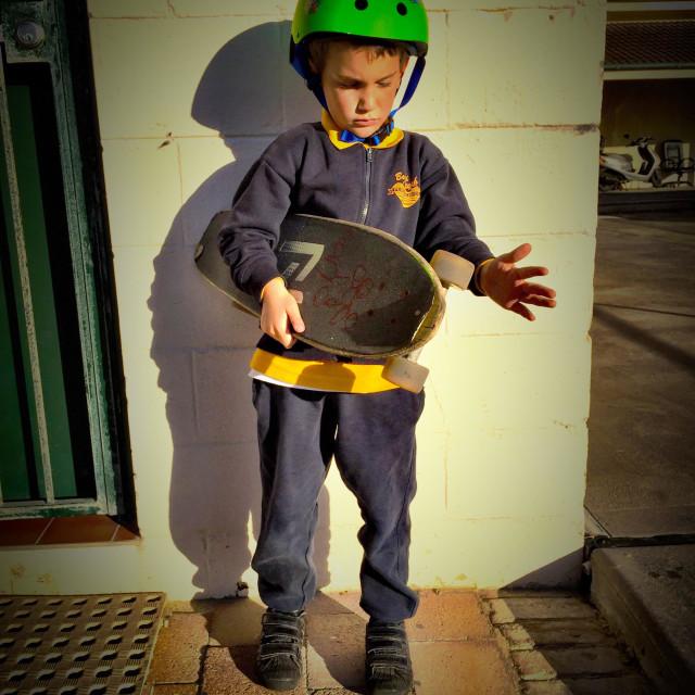 """Skate board boy getting ready to skate."" stock image"