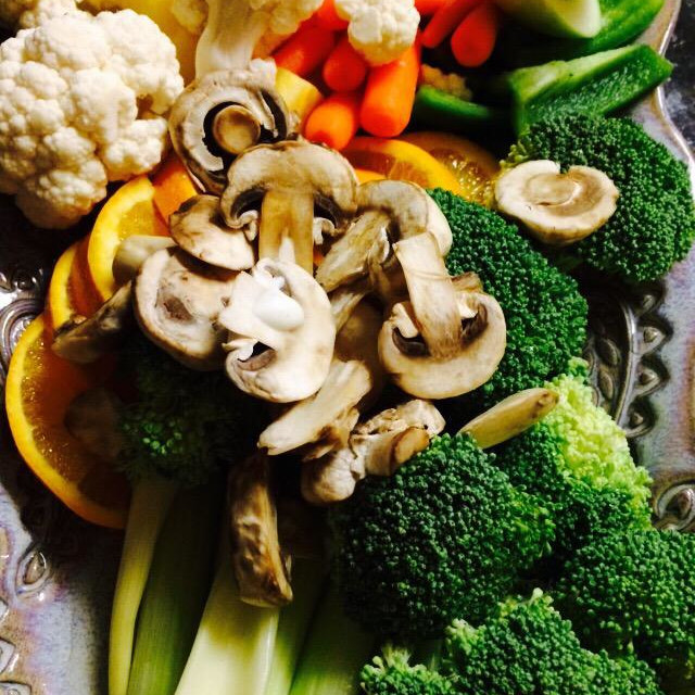 """""""Vegetable and Fruit plate with broccoli, celery, cauliflower, mushrooms, apples, carrots, and oranges."""" stock image"""