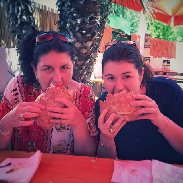 """Mother and daughter eating a kebab, Lloret de mar"" stock image"