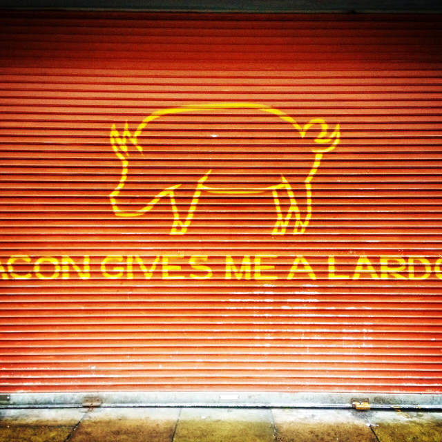 """""""Shop shutters with the words Bacon Gives Me A Lardon"""" stock image"""