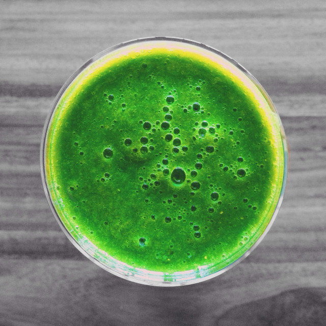 """""""Colorful green smoothie on colorless grey background"""" stock image"""