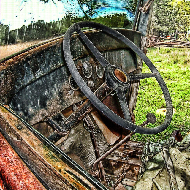 """Vintage 1920s truck interior on abandoned farm land"" stock image"