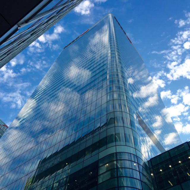 """""""Reflection of clouds in windows of HSBC bank building at Canary Wharf, London"""" stock image"""