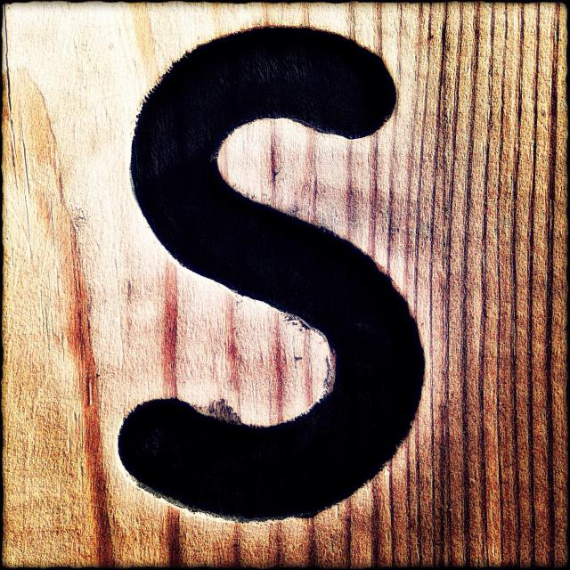 """The letter S on a wooden surface, London, England, United Kingdom, Europe"" stock image"