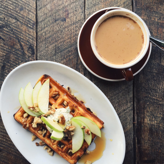 """""""Savory waffle with Gorgonzola butter, walnuts, and apples with coffee on the side"""" stock image"""