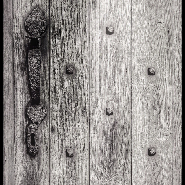 """Studded medieval door"" stock image"