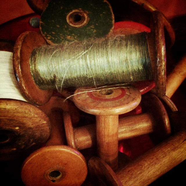 """A number of sewing bobbins"" stock image"