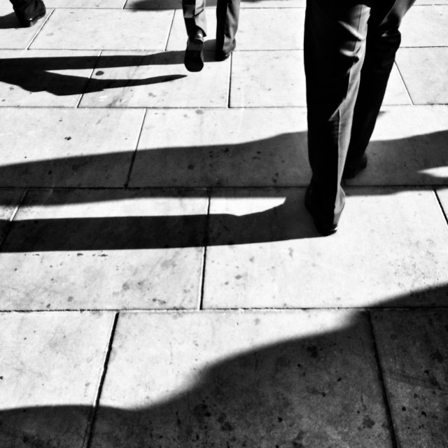 """""""Commuters (black and white legs and shadows)"""" stock image"""
