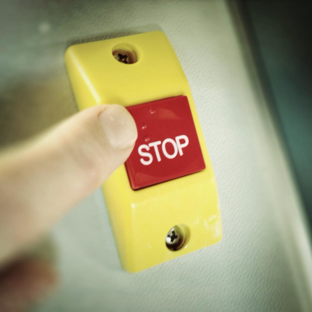 """""""Red stop button with finger about to press it"""" stock image"""