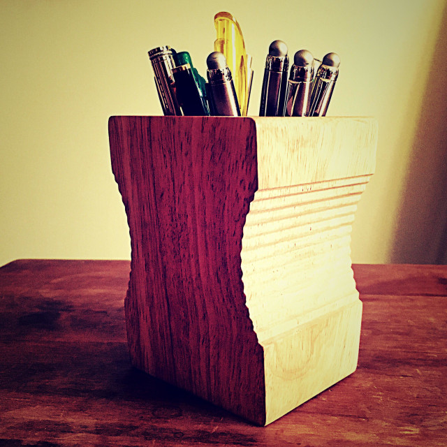 """Pen in wooden pencil sharpener holder"" stock image"