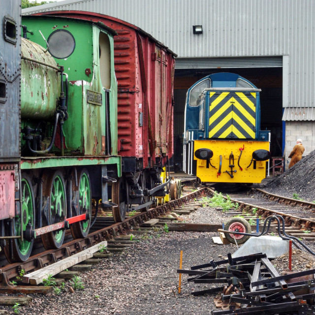 """Colourful trains and rolling stock in the engine yard at the Nene Valley Railway, Wansford, UK"" stock image"