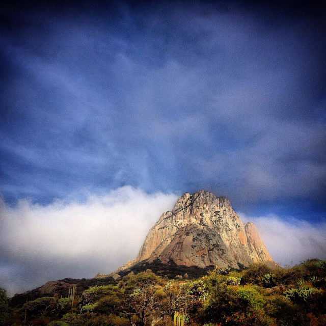 """A picture of Peña de Bernal monolite rock seen from the Hostal Medieval, Peña de Bernal, Ezequiel Montes. Queretaro, Mexico"" stock image"