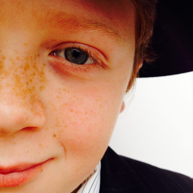 """""""Freckles on the face of a red haired 10-year old boy"""" stock image"""