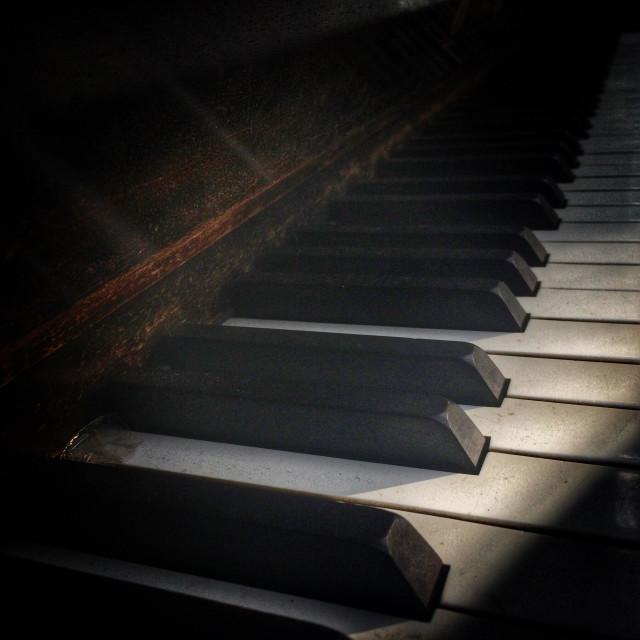 """Piano keys on old vintage piano"" stock image"