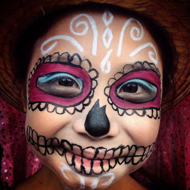 """""""A young Catrina smiles in Mexico City. The Day of the Dead celebration mixes Pre-Hispanic traditions with the European tradition of the Catholic All Souls Day."""" stock image"""