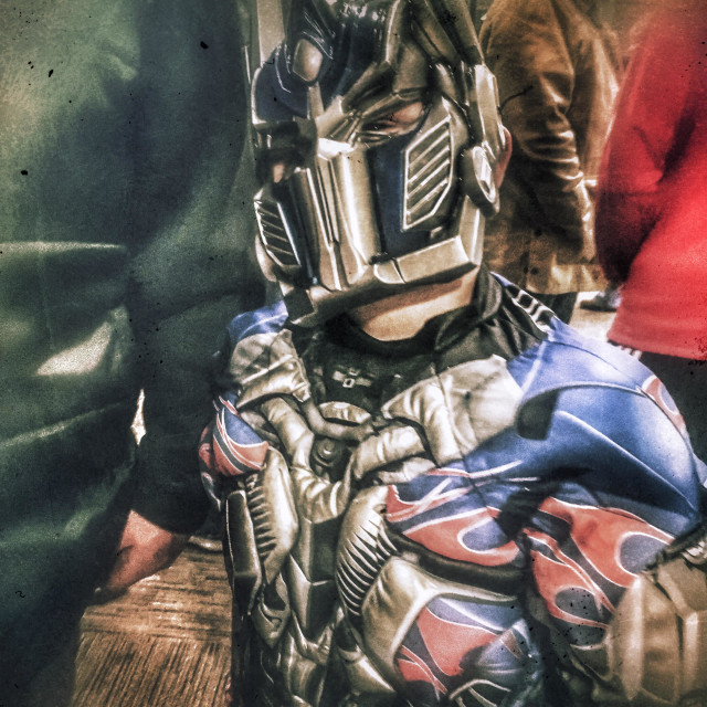 """""""A child in a Transformer Halloween costume (Optimus Prime)."""" stock image"""