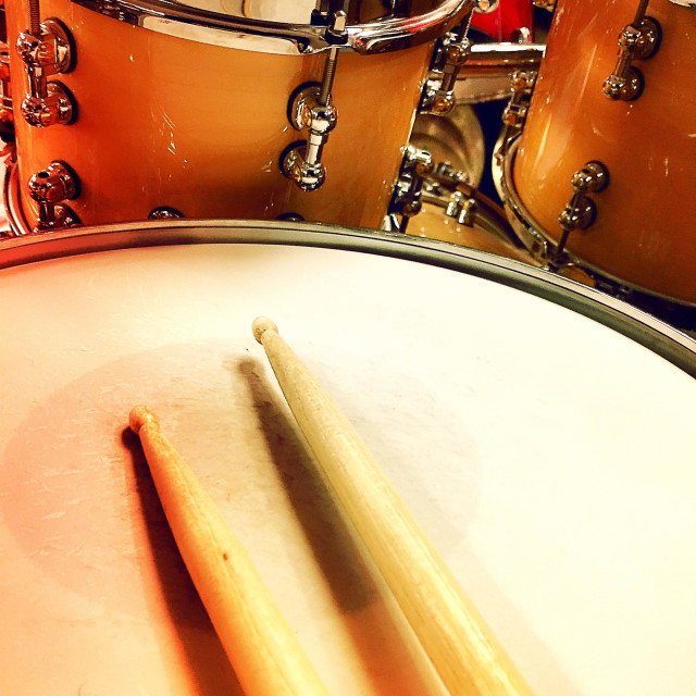 """Drum drum set and drumsticks await the drummer."" stock image"