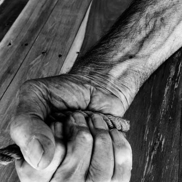 """""""Old man pulling rope"""" stock image"""