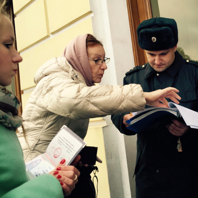 """""""Federal Security Service officers check the documents of the visitors of the Constitutional Court of the Russian Federation."""" stock image"""