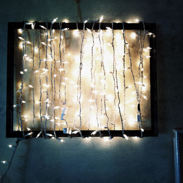 """""""string of white Holiday lights wrapped around empty black picture frame"""" stock image"""