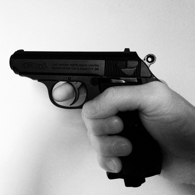 """""""Walther PPK pistol finger on the trigger"""" stock image"""
