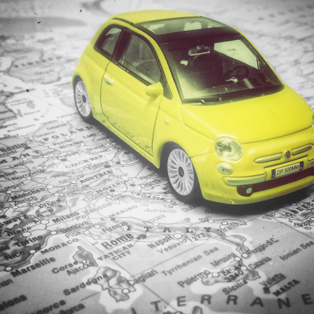 """""""Colour poping of a FIAT 500 on a map of Italy."""" stock image"""